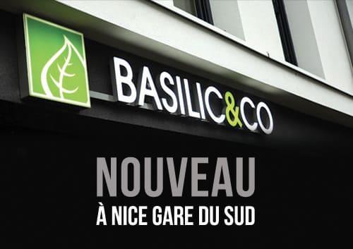 """Photo de l'enseigne Basilic & Co avec l'inscription """"nouveau à Nice Gare du Sud"""""""